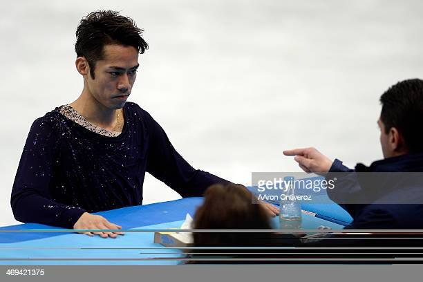 Japan's Daisuke Takahashi prepares for his performance during the men's figure skating free skate Sochi 2014 Winter Olympics on Friday February 14...