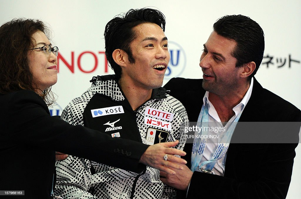 Japan's Daisuke Takahashi (C) reacts after his men free skating at the ISU Grand Prix of Figure Skating Final in Sochi on December 8, 2012.