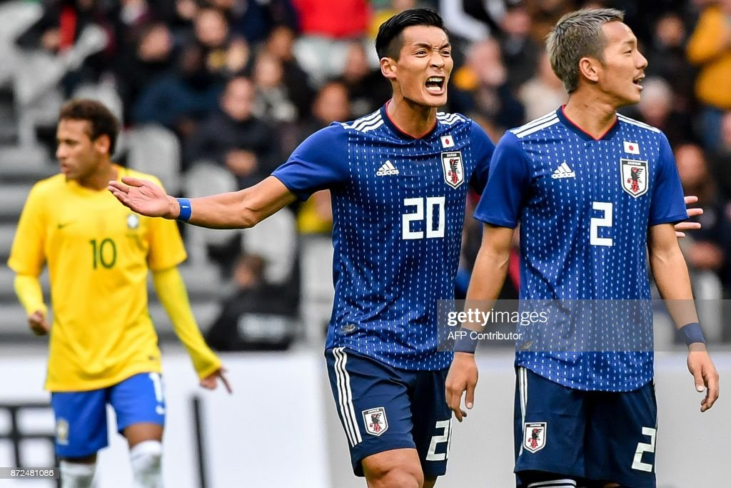 Japan's defender Makino Tomoaki (C) celebrates after scoring a goal during the friendly football match between Japan and Brazil on November 10, 2017 at the Pierre Mauroy Stadium in Villeneuve d'Ascq, northern France. /