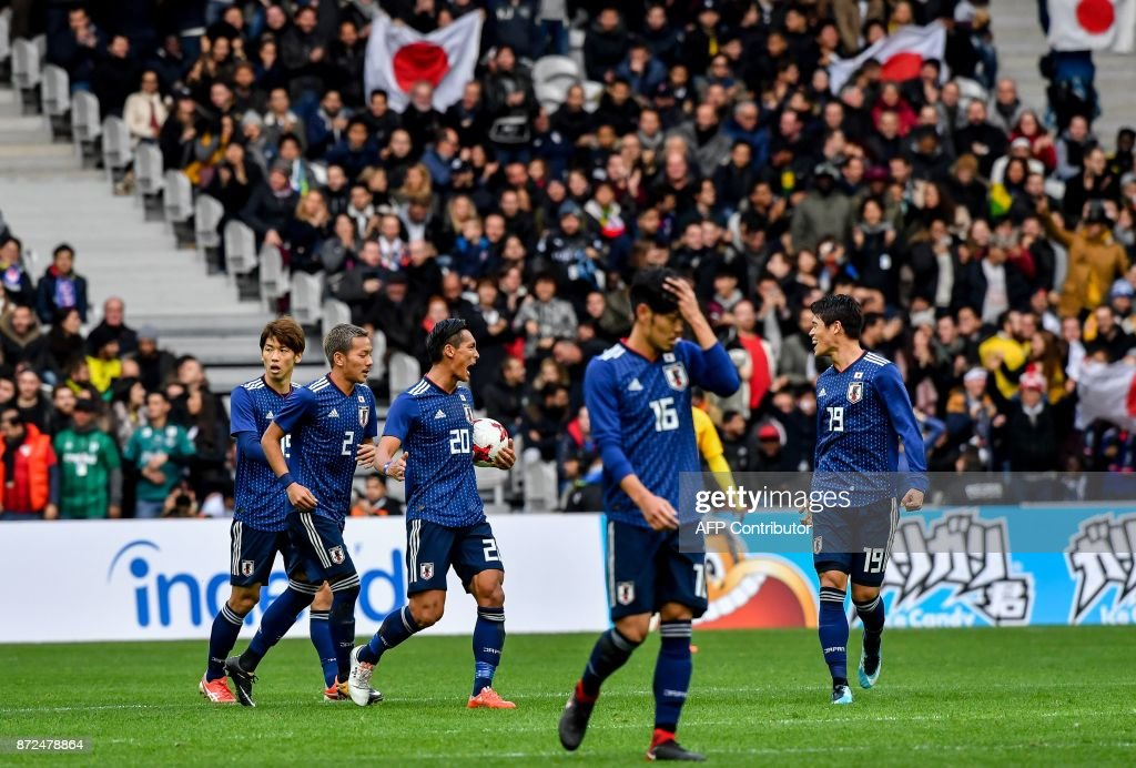 Japan's defender Makino Tomoaki (3rd L) celebrates with teammates after scoring a goal during the friendly football match between Japan and Brazil on November 10, 2017 at the Pierre Mauroy Stadium in Villeneuve d'Ascq, northern France. /