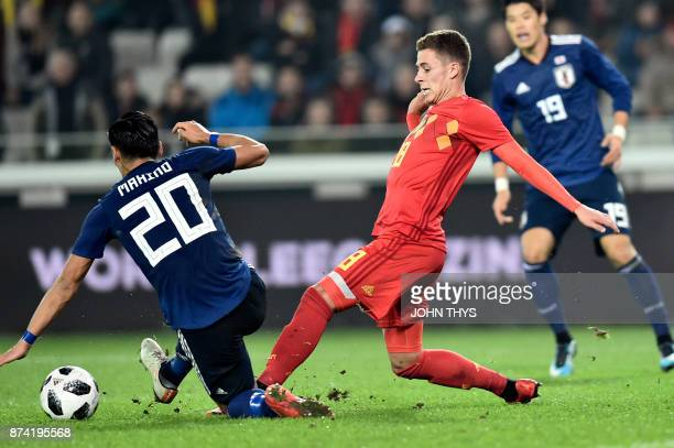 Japan's defender Tomoaki Makino vies with Belgium's defender Thorgan Hazard during the friendly football match Belgium vs Japan on November 14 2017...