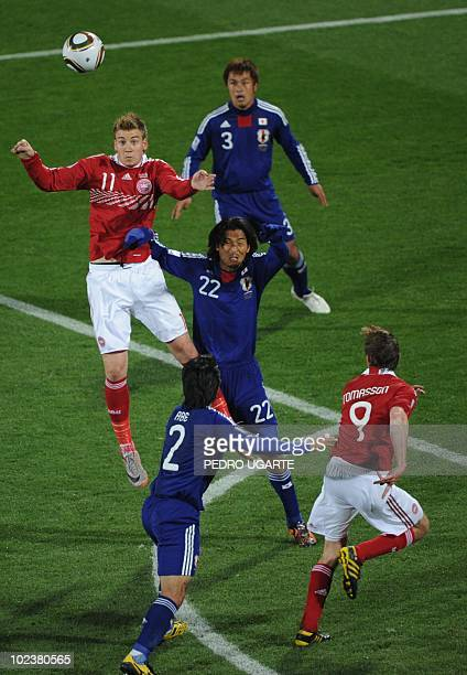 Japan's defender Yuji Nakazawa fights for the ball with Japan's striker Keiji Tamada during the Group E first round 2010 World Cup football match...