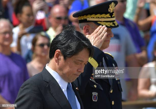 Japan's Defense Minister Itsunori Onodera pays his respects during a wreath laying ceremony at the Tomb of the Unknown Soldier at Arlington National...