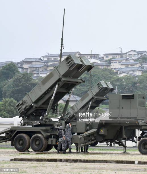 Japan's Defense Ministry opens to the media a drill on the deployment of Patriot Advanced Capability3 surfacetoair guided interceptors at the Ground...