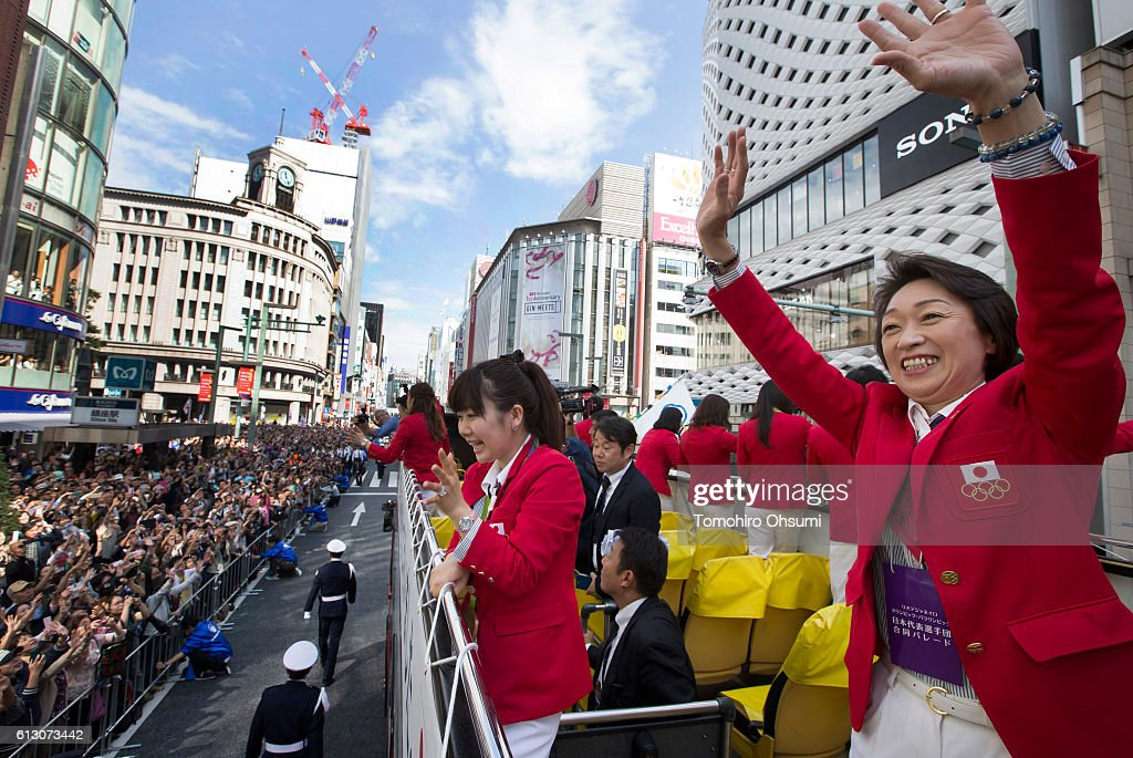 Japan's delegation chief Seiko Hashimoto, right, and Ai Fukuhara, second from right., wave from the top of a double decker bus during the Rio Olympics 2016 Japanese medalist parade in the ginza district on October 7, 2016 in Tokyo, Japan.
