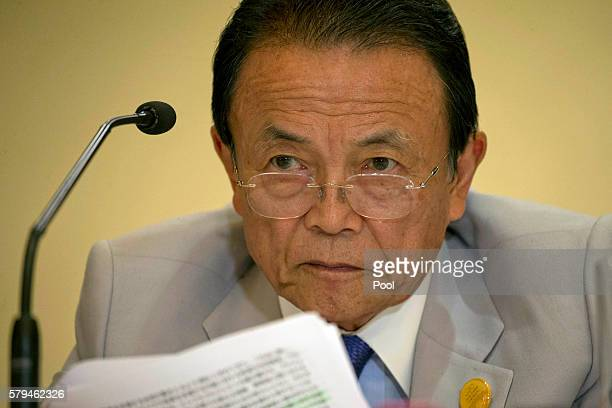 Japan's Deputy Prime Minister Taro Aso attends a press conference held at the close of the G20 Finance Ministers and Central Bank Governors meeting...