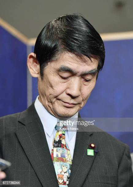 Japan's disaster reconstruction minister Masahiro Imamura looks down while speaking to reporters at a hotel in Tokyo on April 25 following his latest...