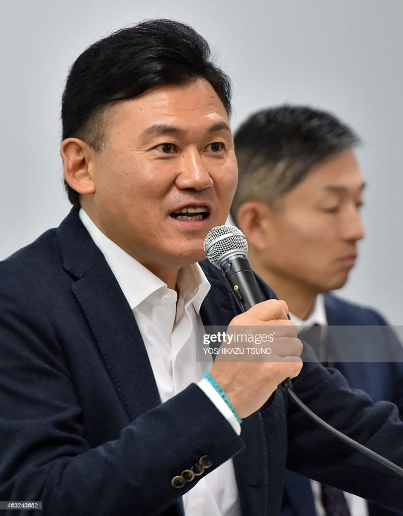 Japan's e-commerce giant Rakuten president <a gi-track='captionPersonalityLinkClicked' href=/galleries/search?phrase=Hiroshi+Mikitani&family=editorial&specificpeople=2208204 ng-click='$event.stopPropagation()'>Hiroshi Mikitani</a> announces the company's financial result ended December at the Rakuten headquarters in Tokyo on February 12, 2015. Rakuten group posted revenue of 4.98 billion USD (598 billion yen), up 15.4% from previous year, operating income of 106 billion yen (883 million USD), up 17.9% year-on-year. AFP PHOTO / Yoshikazu TSUNO