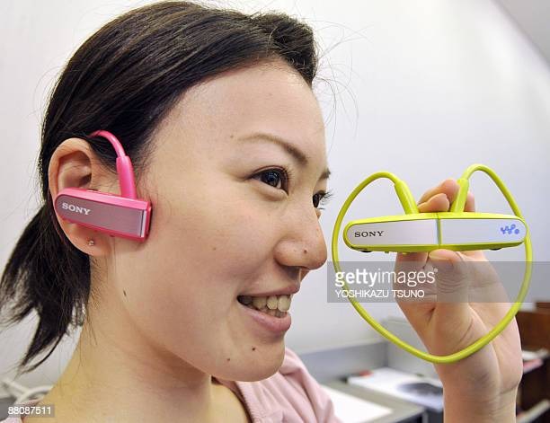 Japan's electronics giant Sony employee Ayano Iguchi displays the new digital audio player 'Walkman Wseries' equipped with builtin 2GB memory to...