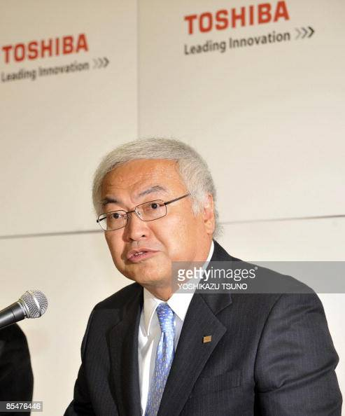 Japan's electronics giant Toshiba executive vice president Norio Sasaki speaks during a press conference at the company headquarters in Tokyo on...