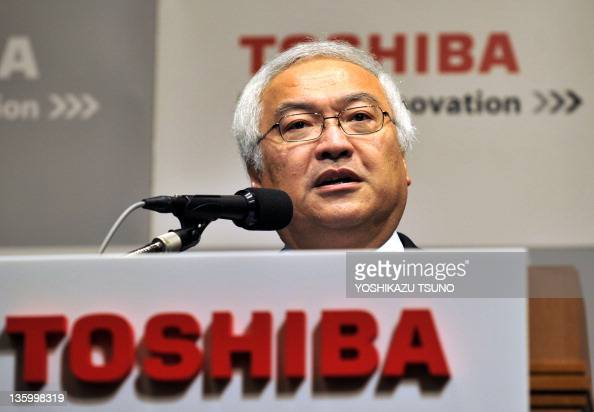 Japan's electronics giant Toshiba president Norio Sasaki speaks before press in Tokyo on December 16 2011 Toshiba has been selected as lead...