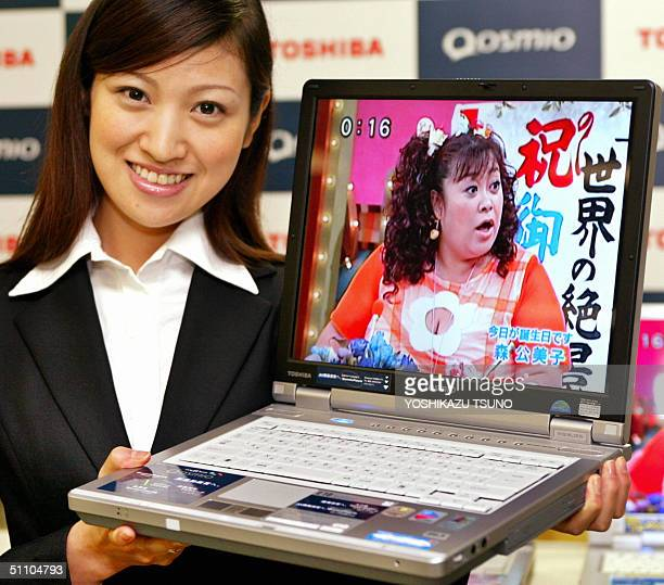 Japan's electronics giant Toshiba unveils its new laptop computer 'Qosmio' at the company's headquarters in Tokyo 22 July 2004 The 'Qosmio' is...