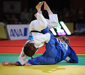 Japan's Emi Yamagishi battles with French's Frederique Jossinet on February 7 2009 during their women final round in the 48 kg category at the Paris...