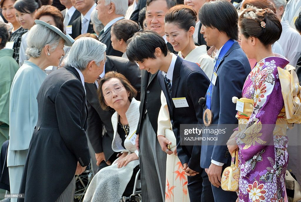 Japan's Emperor Akihito (2nd L) and Empress Michiko (L) greet Japanese medalists at the Sochi Olympics, Yuzuru Hanyu (3rd R), Noriaki Kasai (2nd R), and Tomoka Takeuchi (R), during the annual spring garden party at the Akasaka Palace imperial garden in Tokyo on April 17, 2014.