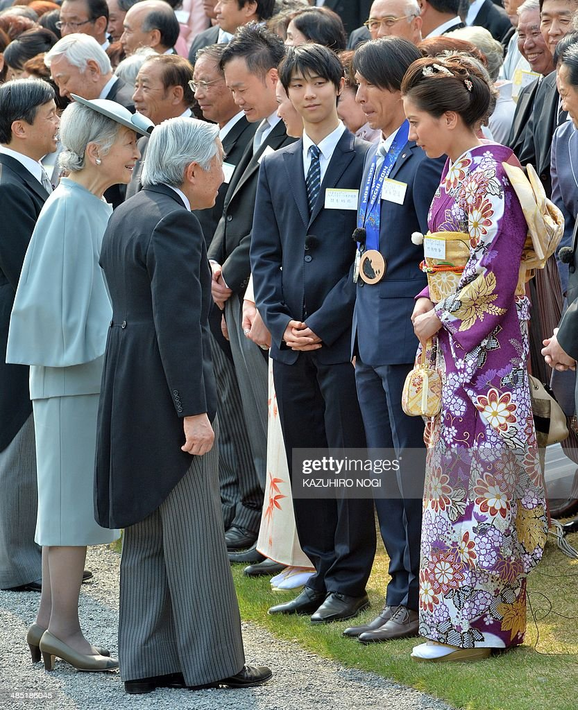 Japan's Emperor Akihito (3rd L) and Empress Michiko (2nd L) greet Japanese medalists at the Sochi Olympics, Yuzuru Hanyu (3rd R), Noriaki Kasai (2nd R), and Tomoka Takeuchi (R), during the annual spring garden party at the Akasaka Palace imperial garden in Tokyo on April 17, 2014.