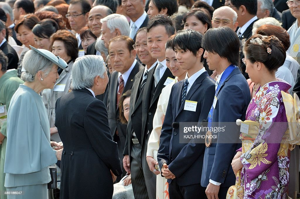 Japan's Emperor Akihito (front 2nd L) and Empress Michiko (front L) greet Japanese medalists at the Sochi Olympics, Yuzuru Hanyu (3rd R), Noriaki Kasai (2nd R), and Tomoka Takeuchi (R), during the annual spring garden party at the Akasaka Palace imperial garden in Tokyo on April 17, 2014.