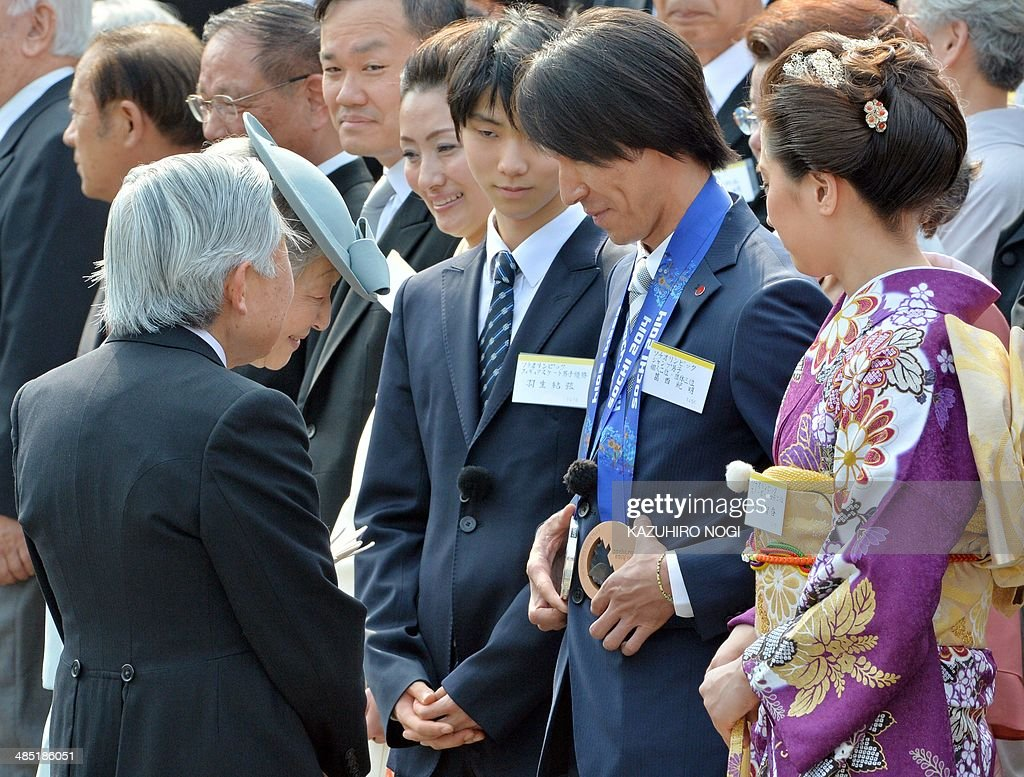 Japan's Emperor Akihito (front L) and Empress Michiko (front 2nd L) greet Japanese medalists at the Sochi Olympics, Yuzuru Hanyu (3rd R), Noriaki Kasai (2nd R), and Tomoka Takeuchi (R), during the annual spring garden party at the Akasaka Palace imperial garden in Tokyo on April 17, 2014. AFP PHOTO / KAZUHIRO NOGI