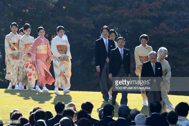 Japan's Emperor Akihito and Empress Michiko lead members of their family including Crown Prince Naruhito Crown Princess Masako Prince Akishino...