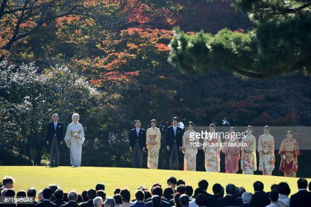 TOPSHOT Japan's Emperor Akihito and Empress Michiko pose with family members Crown Prince Naruhito Crown Princess Masako Prince Akishino Princess...