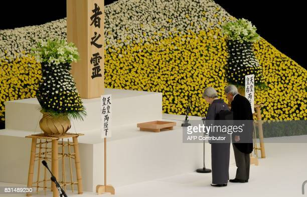 TOPSHOT Japan's Emperor Akihito and Empress Michiko pray for war victims during the official annual memorial service in Tokyo on August 15 on the...