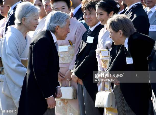 Japan's Emperor Akihito and Empress Michiko talk with Japanese ballet dancer Hana Sakai and musician Tetsuya Komuro during an Imperial garden party...