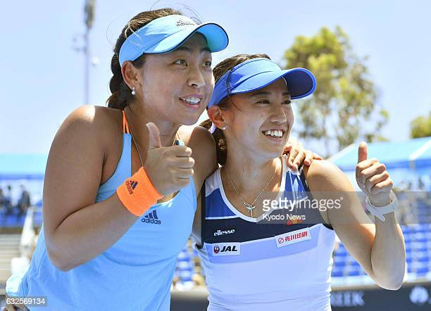 Japan's Eri Hozumi and Miyu Kato celebrate after defeating Croatia's Mirjana LucicBaroni and German Andrea Petkovic 63 63 in the women's doubles...