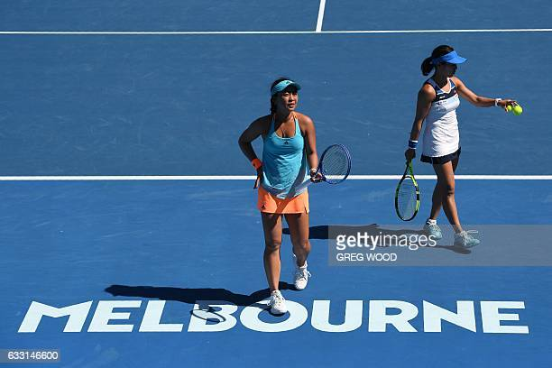 Japan's Eri Hozumi and Miyu Kato prepare to play a point during their women's doubles semifinal match against Bethanie MattekSands of the US and...