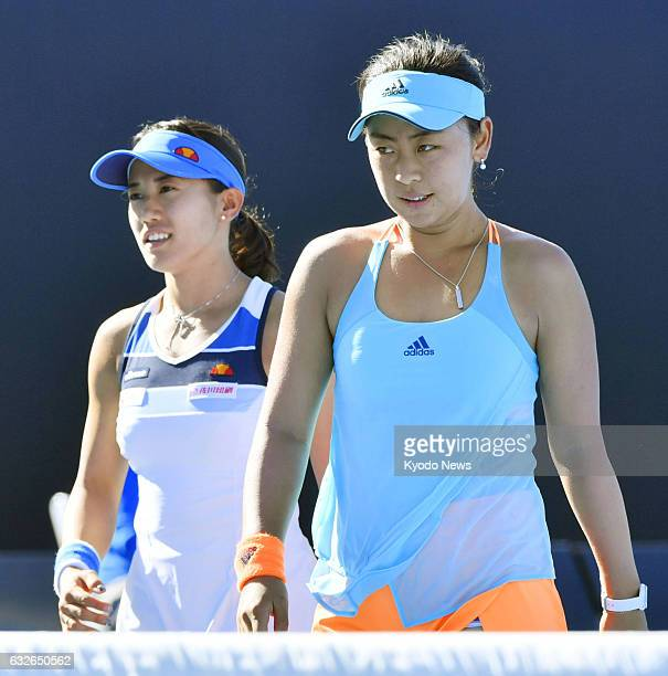 Japan's Eri Hozumi and Miyu Kato react after losing to Bethanie MattekSands of the United States and Czech Lucie Safarova in the Australian Open...