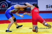 Japan's Eri Tosaka and Venezuela's Mayelis Yesenia Caripa Castillo fight for the gold medal during the women's free style 48 kg category final of the...