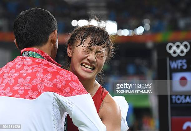 Japan's Eri Tosaka celebrates after winning in the women's 48kg freestyle wrestling event at the Carioca Arena 2 in Rio de Janeiro on August 17...
