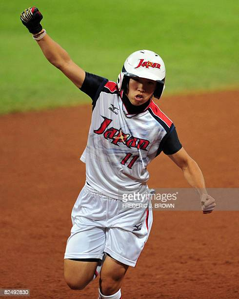 Japan's Eri Yamada celebrates after her fouth inning homerun off a hit off a pitch by Cat Osterman in their gold medal final at the Fengtai Softball...