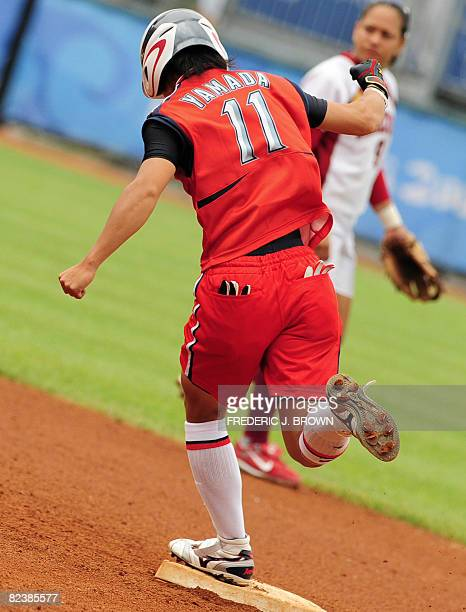 Japan's Eri Yamada celebrates while crossing second base following her fifth inning homerun against Venezuela in their women's preliminary round...