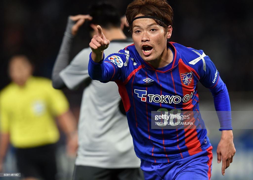 Japan's FC Tokyo midfielder Keigo Higashi (R) celebrates his goal during the AFC champions league play-off match against Thailand's Chonburi FC in Tokyo on February 9, 2016. AFP PHOTO / TOSHIFUMI KITAMURA / AFP / TOSHIFUMI KITAMURA