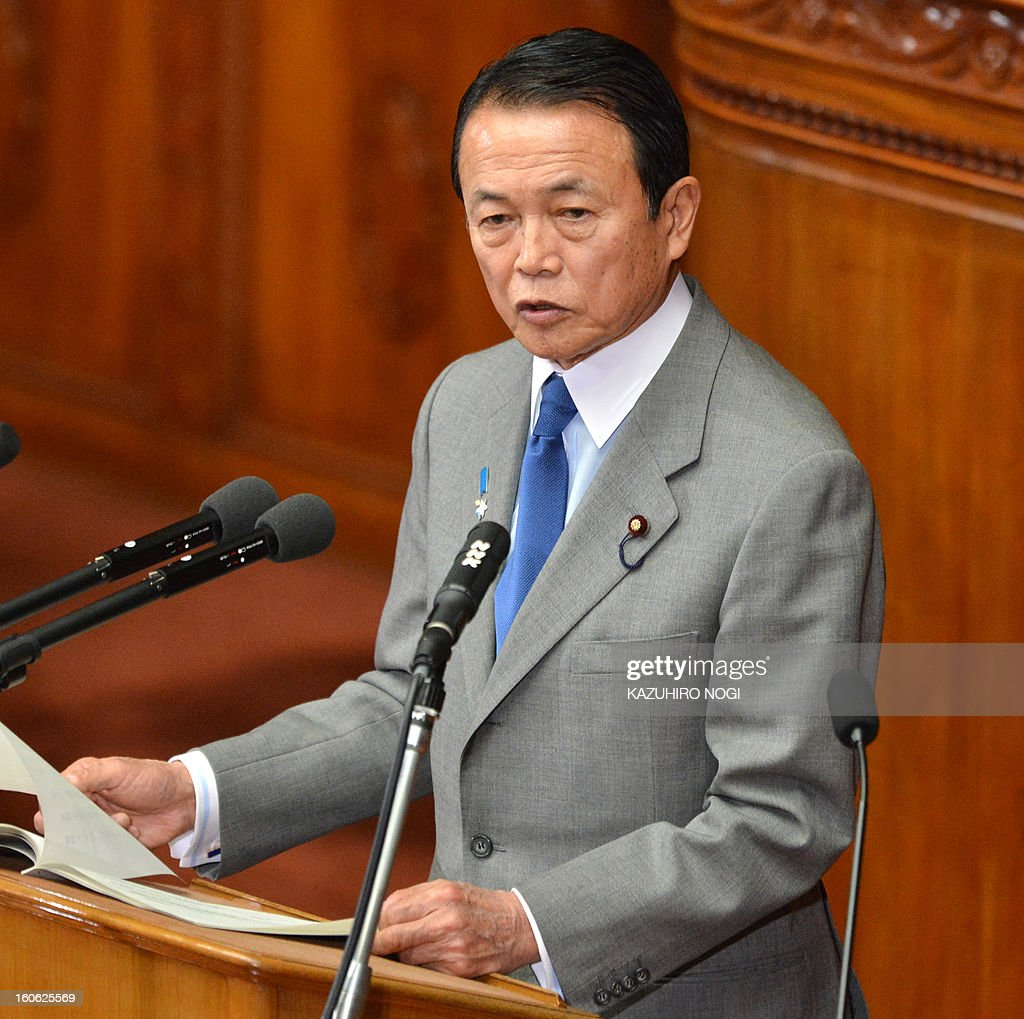 Japan's Finance Minister Taro Aso delivers a speech in the lower house plenary session at parliament in Tokyo on February 4, 2013. Japan's cabinet January 29 approved a 1.02 trillion USD annual budget with boosts in defence and public works spending amid a festering territorial row with China and a renewed assault on deflation.