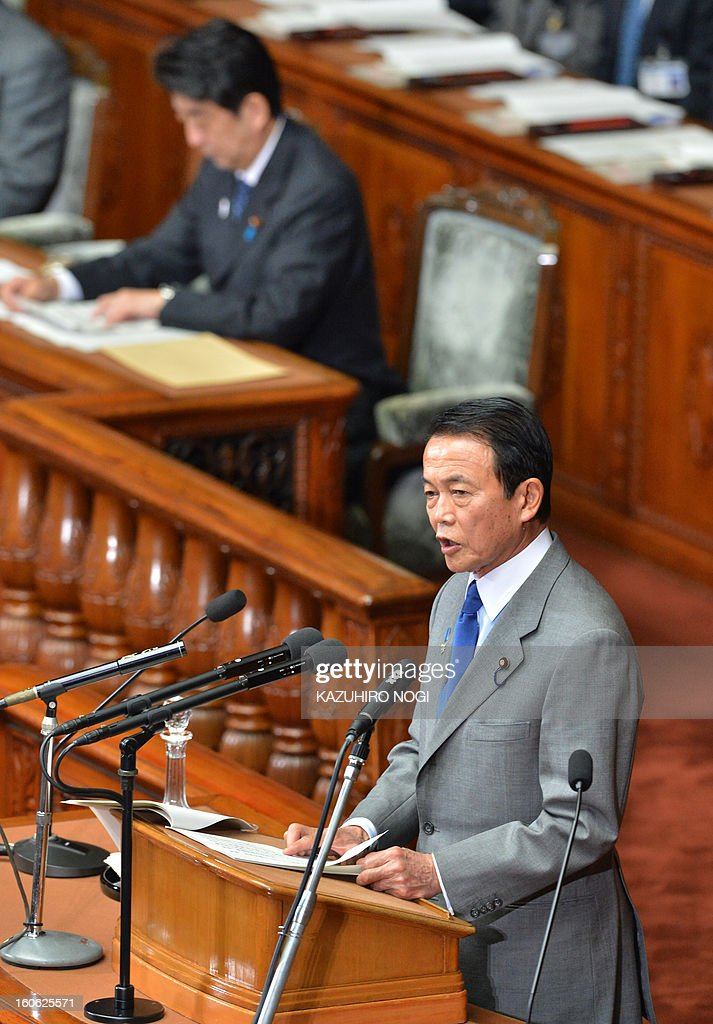 Japan's Finance Minister Taro Aso (bottom) delivers a speech in the lower house plenary session at parliament in Tokyo on February 4, 2013. Japan's cabinet January 29 approved a 1.02 trillion USD annual budget with boosts in defence and public works spending amid a festering territorial row with China and a renewed assault on deflation. AFP PHOTO / KAZUHIRO NOGI