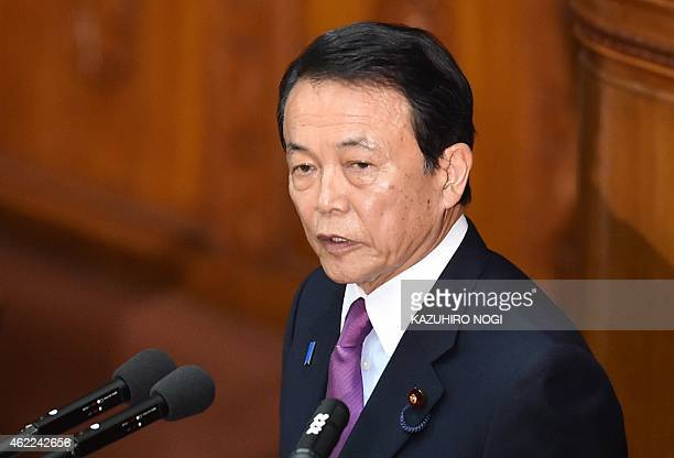 Japan's Finance Minister Taro Aso delivers a speech on the first day of the 150day ordinary Diet session at the National Diet in Tokyo on January 26...
