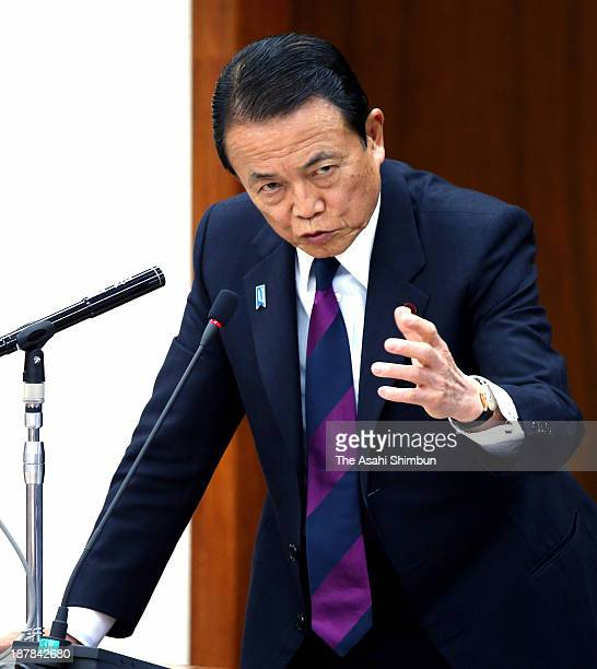 Japan's Finance Minister Taro Aso speaks during a fiscal and financial committee of the lower house at the diet on November 13 2013 in Tokyo Japan...