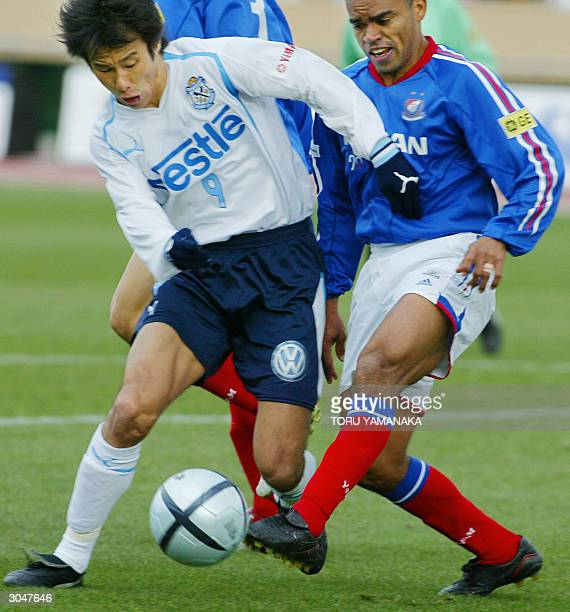 Japan's football club Jubilo Iwata forward Masashi Nakayama battles for the ball with Brazilan defender Dutra of Yokohama F Marinos during the...