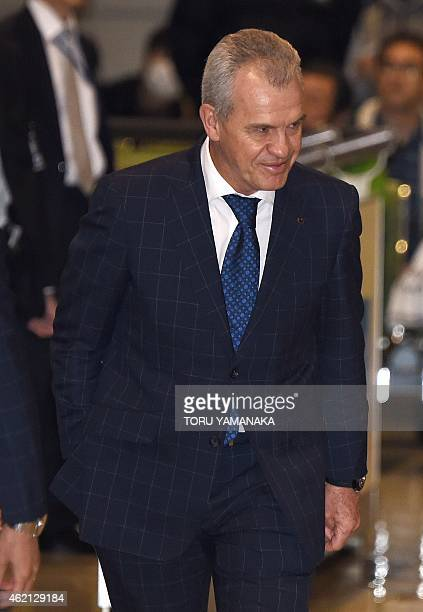 Japan's football coach Javier Aguirre of Mexico greets to football fans upon his arrival at Narita Airport suburban Tokyo after being defeated by UAE...