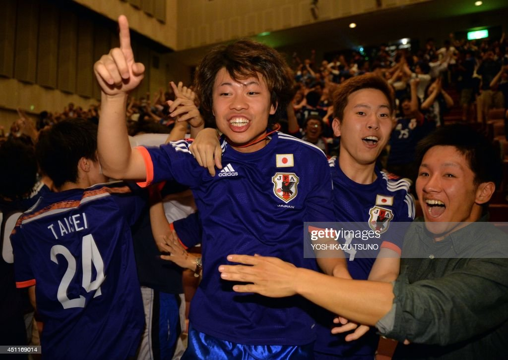 Japan's football supporters celebrate Japan's goal against Colombia during a public viewing for the FIFA World Cup group C match in Tokyo on June 25, 2014. Some 400 supporters gathered to cheer Japan's national team. AFP PHOTO / Yoshikazu TSUNO