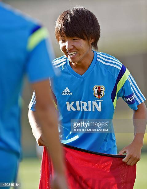 Japan's footballer Daisuke Sakai smiles as he takes part in a training session of Japan's national football team a few days prior to the 2014 FIFA...