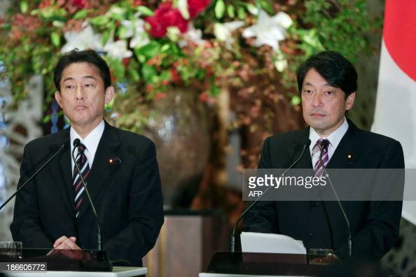 Japan's Foreign Minister Fumio Kishida and Defence Minister Itsunori Onodera attend a joint news conference with Russia's Foreign Minister Sergey...