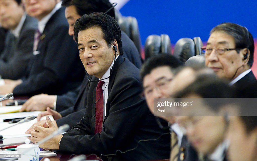 Japan's Foreign Minister <a gi-track='captionPersonalityLinkClicked' href=/galleries/search?phrase=Katsuya+Okada&family=editorial&specificpeople=226520 ng-click='$event.stopPropagation()'>Katsuya Okada</a> (C) smiles during the opening of the China-Japan high level economic dialogue at the Great Hall of the people in Beijing, China, 28 August 2010. The talks are aimed at covering a wide range of economic issues including trade in rare earth metals, essential for a number of high tech products such as hybrid automobiles and mobile phones.
