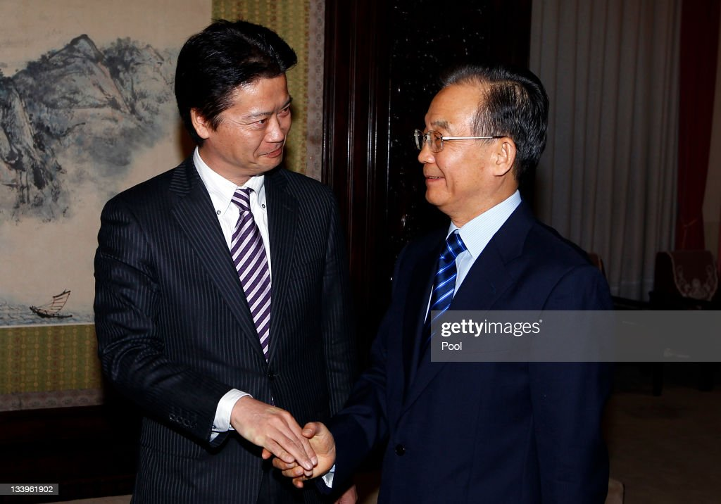 Japan's Foreign Minister <a gi-track='captionPersonalityLinkClicked' href=/galleries/search?phrase=Koichiro+Gemba&family=editorial&specificpeople=7046304 ng-click='$event.stopPropagation()'>Koichiro Gemba</a> (L) shakes hands with Chinese premier <a gi-track='captionPersonalityLinkClicked' href=/galleries/search?phrase=Wen+Jiabao&family=editorial&specificpeople=204598 ng-click='$event.stopPropagation()'>Wen Jiabao</a> during their meeting November 23, 2011in Beijing. Gemba is in Beijing to discuss the avoidance of conflict over disputed waters of the East China Sea gas fields and disputed islands, whcih are known as the Senkaku in Japanese and the Diaoyu in Chinese.
