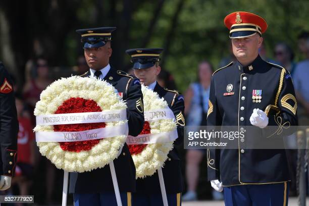 Japan's Foreign Minister Tar Kno and Defense Minister Itsunori Onodera arrive to lay a wreath at the Tomb of the Unknown Soldier at Arlington...