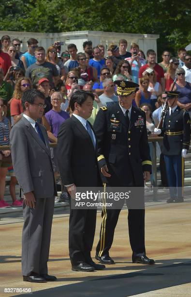 Japan's Foreign Minister Tar Kno and Defense Minister Itsunori Onodera lay a wreath at the Tomb of the Unknown Soldier at Arlington National Cemetery...