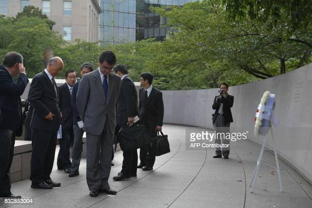 Japan's Foreign Minister Tar Kno visits the Japanese American Memorial to Patriotism During World War II in Washington DC on August 16 2017 / AFP...
