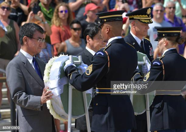 Japan's Foreign Minister Taro Kono and Defense Minister Itsunori Onodera lay a wreath at the Tomb of the Unknown Soldier at Arlington National...