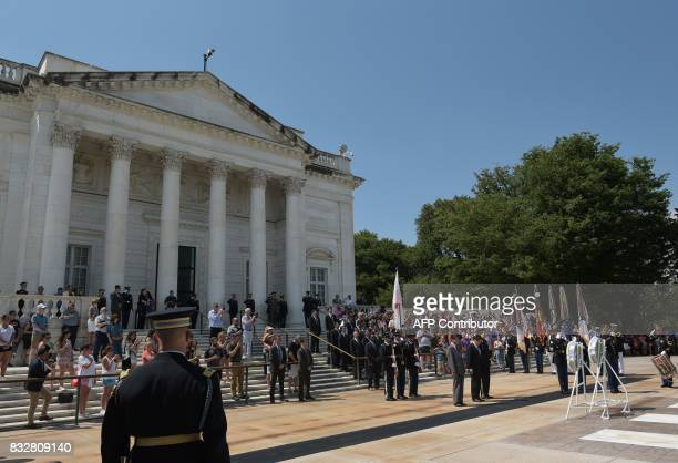 Japan's Foreign Minister Taro Kono and Defense Minister Itsunori Onodera pay their respects during a wreath laying ceremony at the Tomb of the...