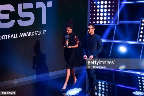 Japan's former player Hidetoshi Nakata and Germany's former player Celia Sasic come on stage to present The Best FIFA Women's Player of 2017 Award...